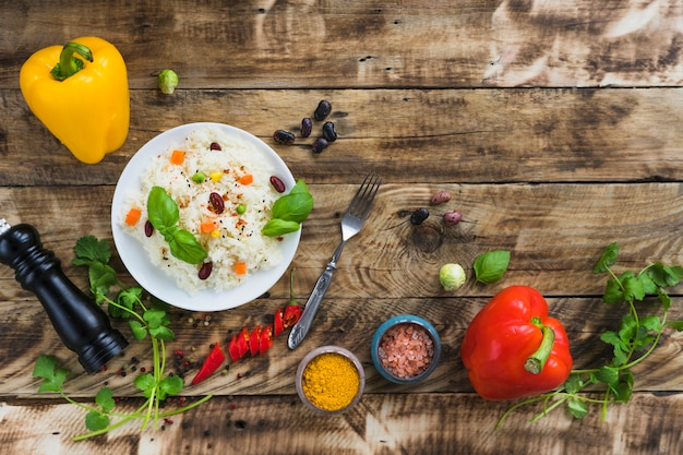 Vegetable beans rice and fresh colorful vegetables over weathered wooden table Free Photo