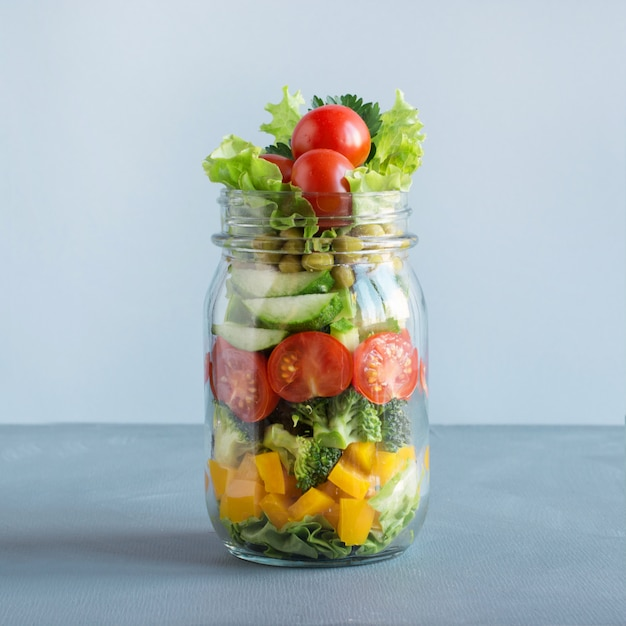 Vegetable salad in mason jar for eating in office. Premium Photo