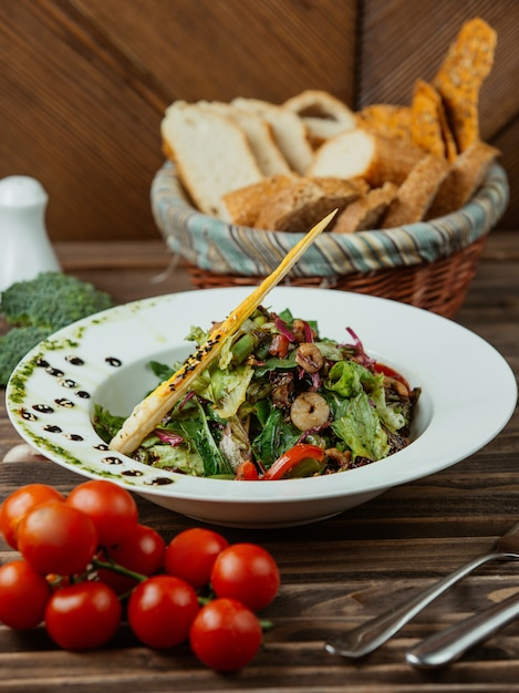 Vegetable salad with tomatoes and herbs Free Photo