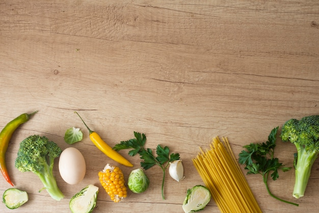 Vegetables egg and corn on table with copy space Free Photo