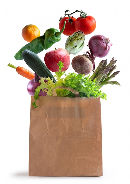 Vegetables flying in recycled paper bag Premium Photo