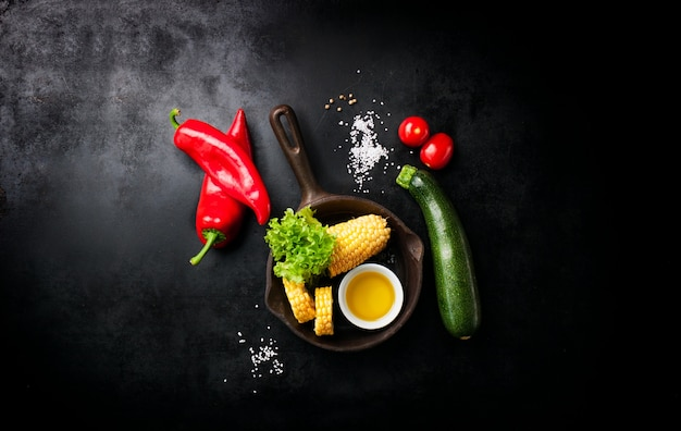 Vegetables and an italian knife placed on a black table Free Photo