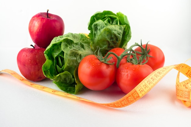 Vegetables with measuring tape on table Free Photo