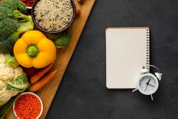 Vegetables with notebook and bell top view Free Photo