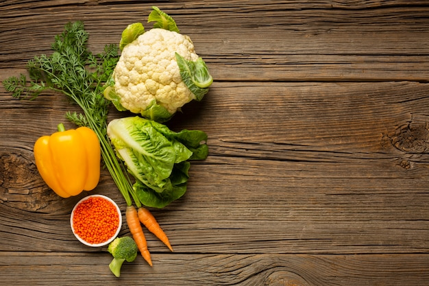 Vegetables on wood table with copy space Free Photo