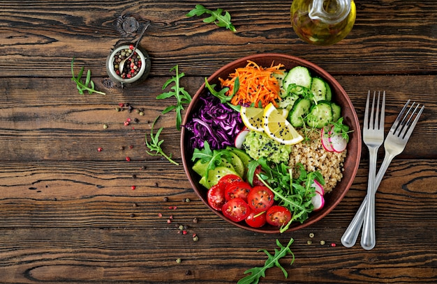 Vegetarian buddha bowl with quinoa and fresh vegetables. healthy food concept. vegan salad. top view. flat lay Premium Photo