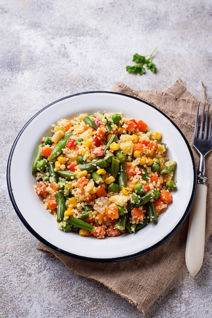 Vegetarian dish couscous with vegetables Premium Photo