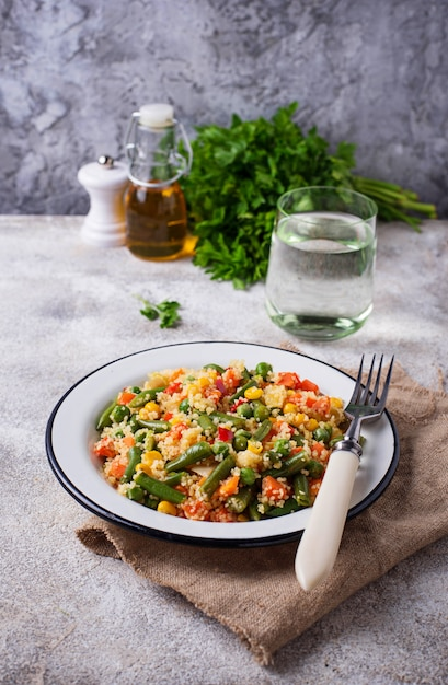 Vegetarian dish couscous with vegetables Premium Photo