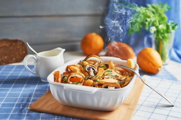 Vegetarian roast without meat with pumpkin, potatoes and mushrooms; pumpkin dish Premium Photo