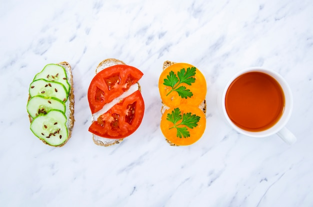 Veggan sandwiches with tea top view Free Photo