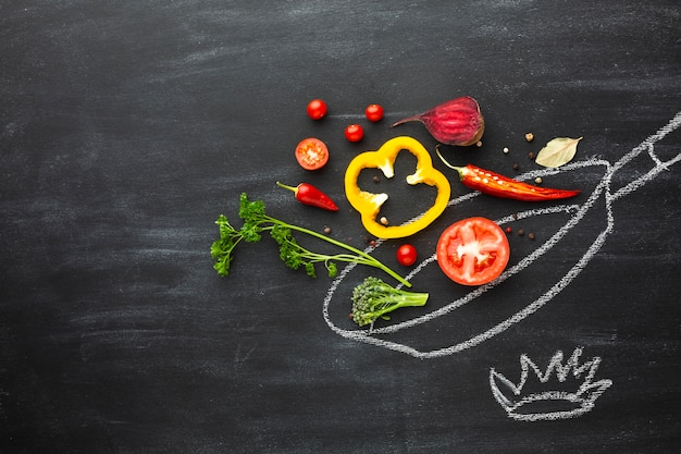 Veggie arrangement on chalk pan Free Photo