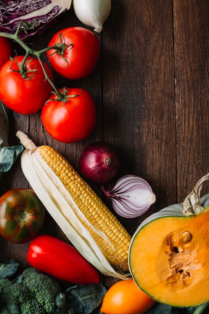 Veggies and tomatoes on wooden copy space background Free Photo