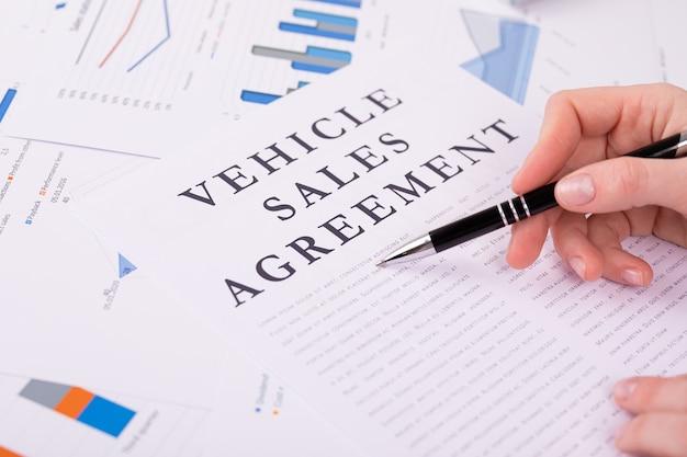 Vehicle sales agreement concept, documents on the desktop Premium Photo