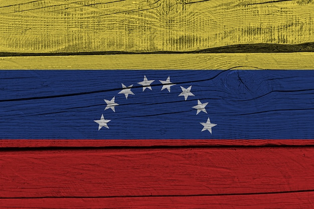 Флаг венесуэлы нарисовал на старой деревянной доске Premium Фотографии