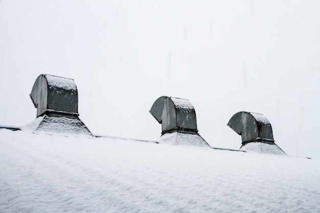 Ventilated roof with snow covered white Premium Photo