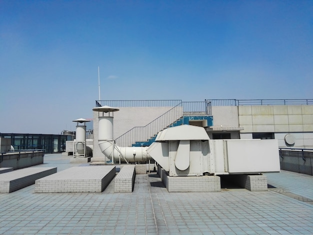 Ventilation duct on building roof Free Photo