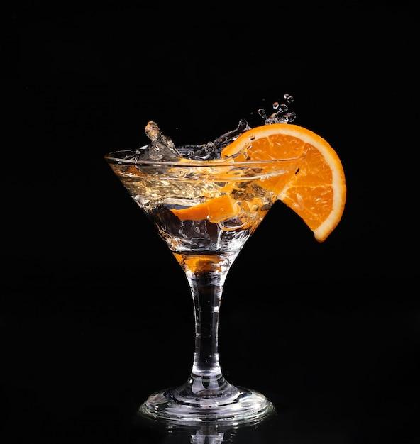 Vermouth cocktail inside martini glass over dark background Premium Photo