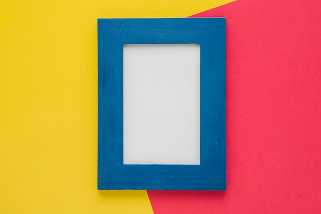 Vertical blue frame with bicolor background Free Photo