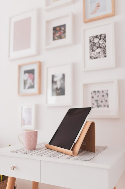 Vertical closeup of a tablet set on a bedside table Free Photo