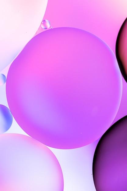 ピンクの背景にピンクのさまざまな色合いで満たされた円の垂直グラフィックイラスト 無料写真