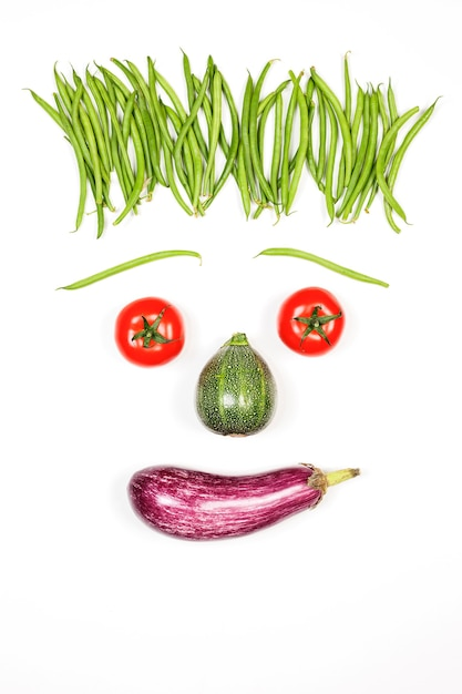 Vertical happy face with vegetables on white background Free Photo