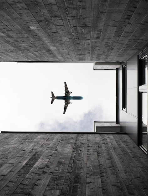 Vertical low angle shot of an airplane flying in the clear sky Free Photo