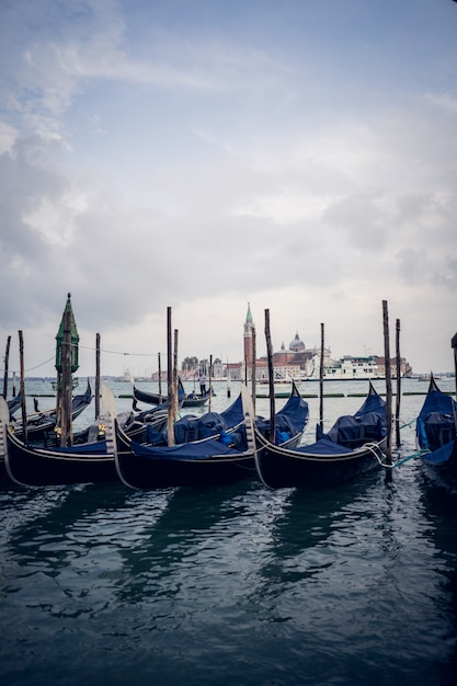 Vertical picture of blue gondolas in a port at daytime Free Photo