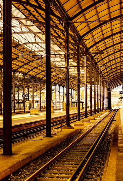 Vertical picture of a railroad station under the sunlight in switzerland Free Photo