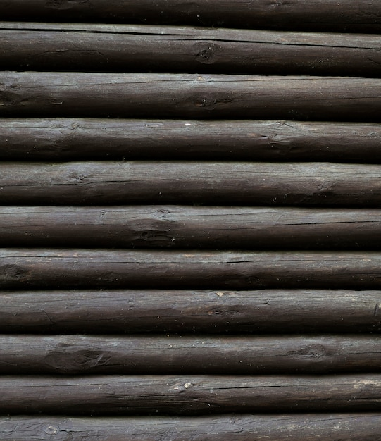 Vertical pile of wooden tree trunks Free Photo