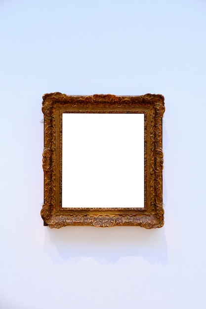 Vertical shot of a bright white sheet framed in a wooden frame Free Photo
