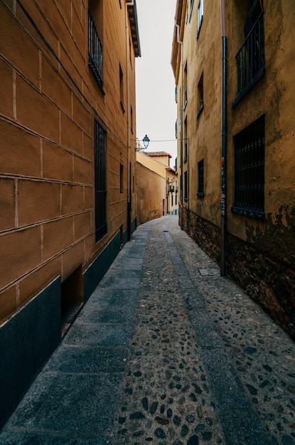 Vertical shot of buildings on old streets in the jewish neighborhood in segovia, spain Free Photo