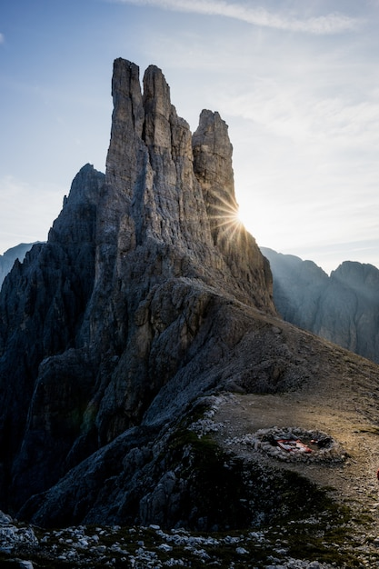 Vertical shot of a fireplace on the mountain with a blue sky in the background Free Photo