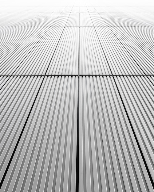 Vertical shot of a grey facade of a building - great for background Free Photo