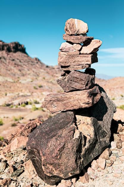 Vertical shot of rocks balancing in arizona desert Free Photo