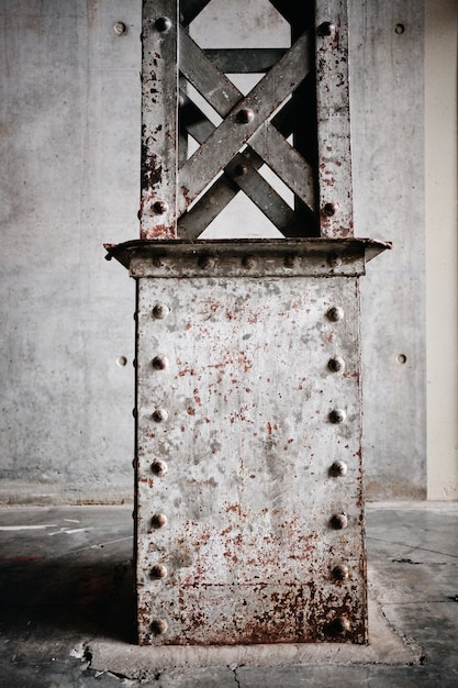 Vertical shot of a rusty metal stand in roubaix, france Free Photo