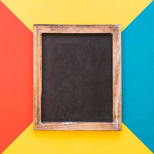 Vertical slate on colorful geometric background Free Photo