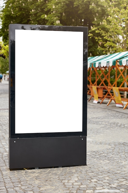 Vertical street billboard with white copy space Free Photo