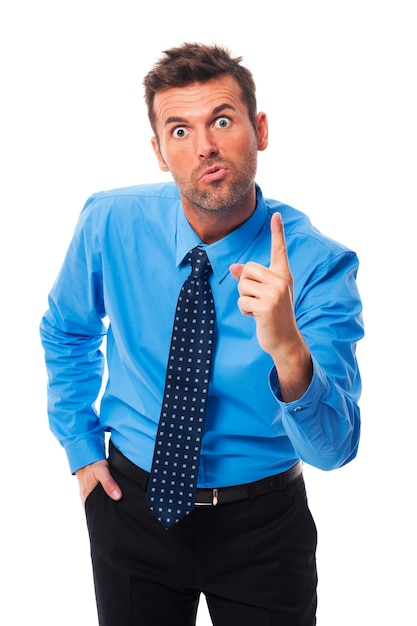 Very angry businessman threatening you Free Photo