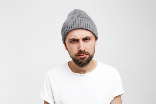 Very bored adult man with beard looking tired and sick Free Photo