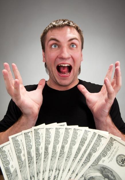 お金で非常に興奮した男 Premium写真