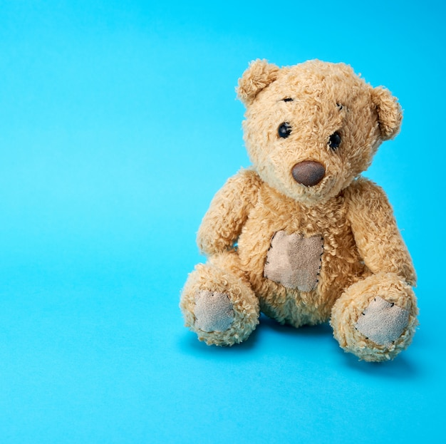 Very old brown teddy bear Premium Photo