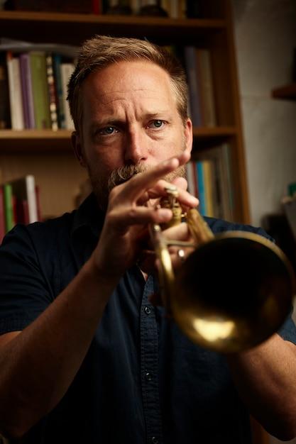 Veteran musician playing the trumpet Free Photo