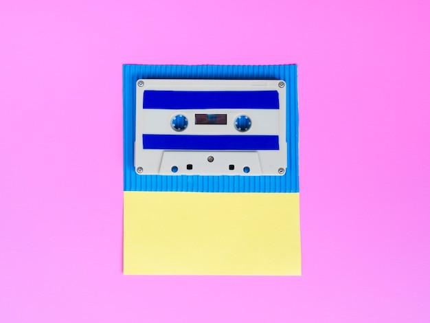 Vibrant cassette tape on bright wallpaper Free Photo
