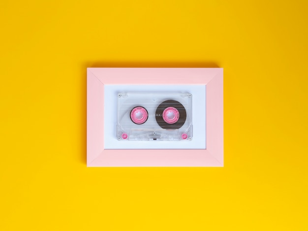 Vibrant clear cassette tape with vivid background color Free Photo