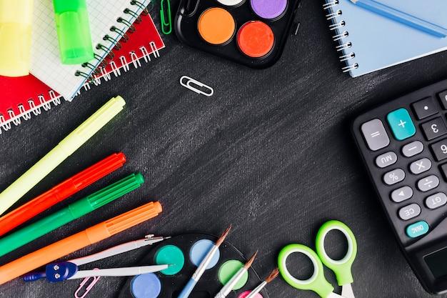 Vibrant stationery for creativity on dark background Free Photo
