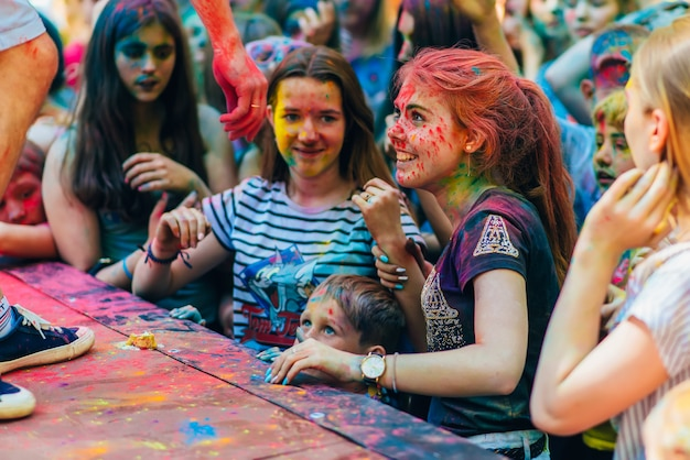 Vichuga, russia - june 17, 2018: happy girls with faces in paint at the festival of colors holi Premium Photo