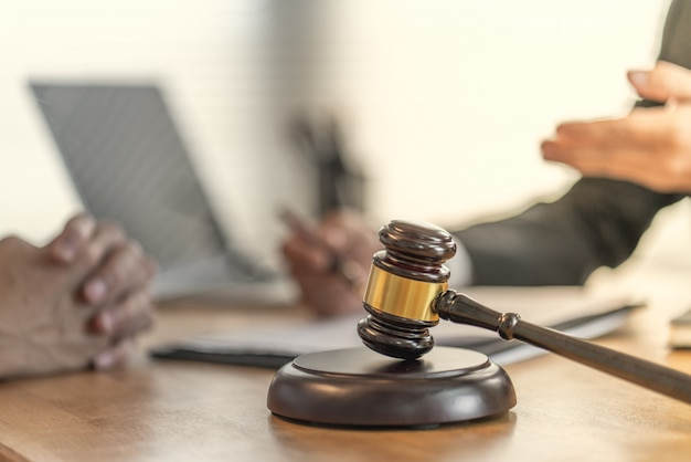 Victims claim with a lawyer about unfair contracts in purchasing homes Premium Photo