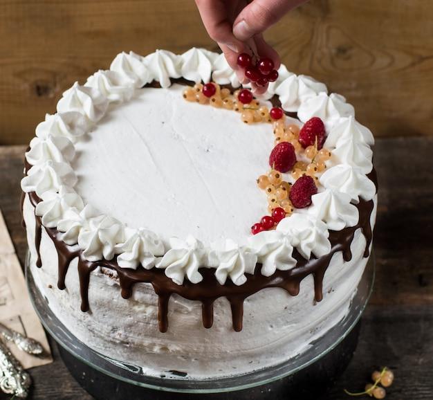 Victoria cake with raspberry, cranberries, mint, red currant. dessert. black forest cake. Premium Photo