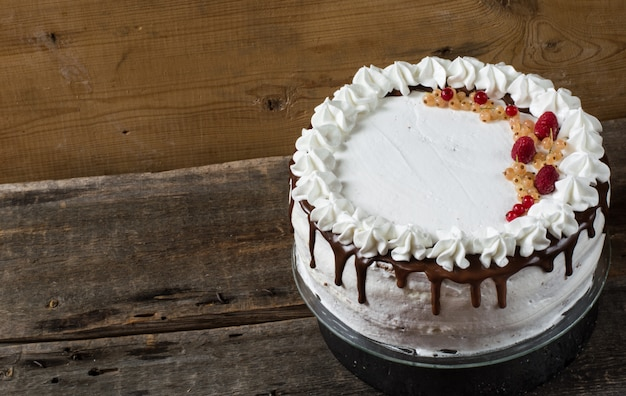 Victoria sandwich cake with strawberries, cranberries, mint on the table. dessert. Premium Photo
