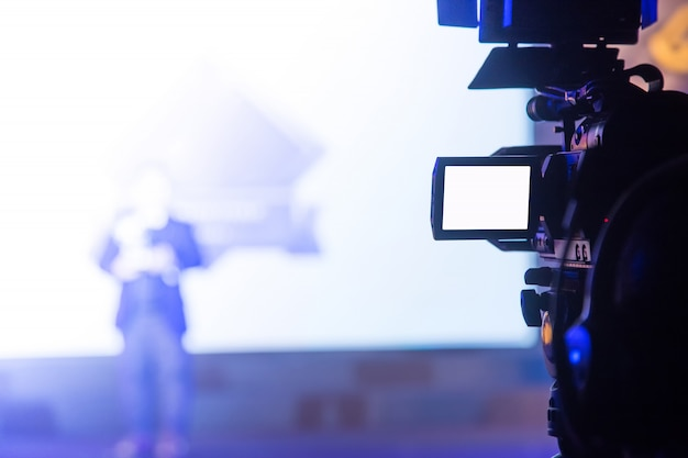 Video camera operator working in the business party Premium Photo